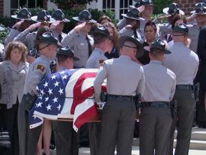 "State troopers escort the body of fellow Trooper Andrew ""AJ"" Stocks during his funeral in Cary on Sept. 13, 2008."