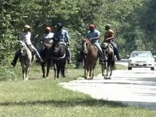 Volunteers on horseback search in Granville County for 28-year-old Kelly Morris on Sept. 13, 2008.