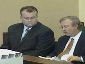 Mark Bowling, left, reviews information on potential jurors with his attorneys during the first day of his murder trial, Sept. 22, 2008.
