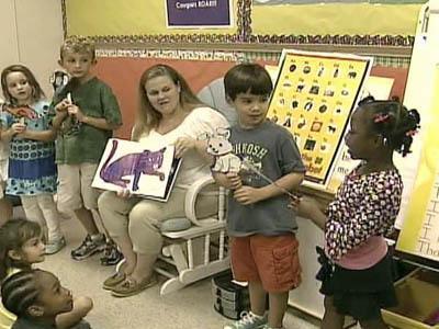 Swift Creek Elementary School teacher Margarette Harris reads a book with her kindergarten class.