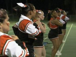 South View High School cheerleaders perform during a football game. They have been ordered not to wear their uniforms to school.