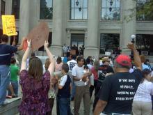 In county divided, vigil seeks unity