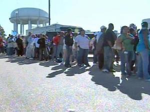 People lined up for hours on Oct. 13, 2008, to submit an application to work at the 2008 North Carolina State Fair.