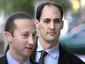 Brad Cooper, right, with his attorney, Howard Kurtz, enters the Wake County Courthouse Oct. 13, 2008.