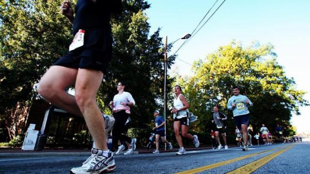 Runners make their way down Hillsborough Street in the middle of the Sony Ericsson City of Oaks Marathon and the Rex Healthcare Half Marathon, held simultaneously on Sunday, Nov. 2, 2012, in Raleigh.