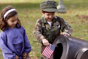 Two children enjoy one of the canons on display during the ceremony.