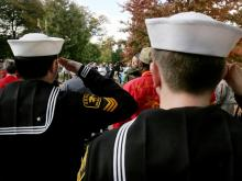Two sailors salute during the Pledge of Allegiance.