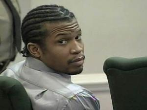 Michael Troy Lewis sits in court on Nov. 12, 2008, as jury selection begins in his kidnapping and robbery trial.