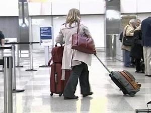 More airlines are starting to charge a fee for checking baggage.