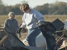 Volunteers help tornado victims clean up