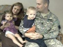 Fort Bragg Chaplain Cpt. Kirby Vidrine (right) and his wife, Wendy Vidrine, hold two of their eight children.