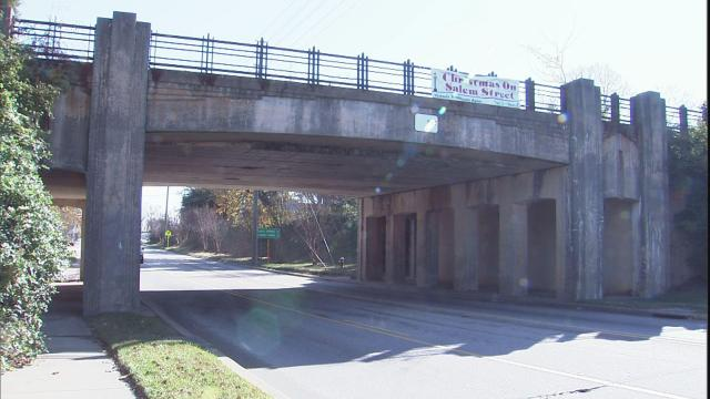 The CSX railroad bridge straddles N.C. Highway 55 and carries about a half dozen trains a day. Roughly 25,000 vehicles pass underneath daily.
