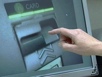 A skimming devices has been placed over the card slot of this ATM.