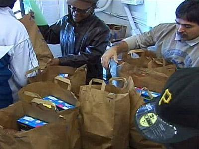 The Opportunities Industrialization Center hands out bags of groceries on Nov. 26, 2008 to help those less fortunate prepare holiday meals.