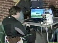 A shopper, equipped with a computer, camps outside of the Best Buy store in Cary on Nov. 27, 2008, in anticipation of Black Friday