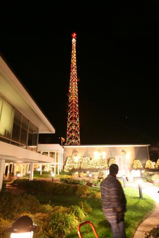 A man enjoys a ground view of the lighted WRAL-TV tower.