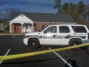 Durham police surround a Bank of America branch, 3807 N. Duke St., to search for people who carjacked the bank manager.