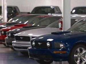 Local dealers say the struggles of the Big Three automakers is unheard of. They're waiting to see how the government's response will affect local business.
