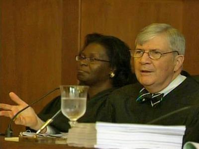 N.C. Supreme Court Justices Patricia Timmons-Goodson and Edward Thomas Brady at Tuesday's year-round school case.