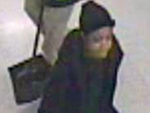 Police believe the woman in this surveillance photo rode in the cab of Michael Howard Palmer before his shooting death.