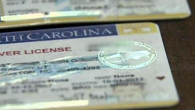 Authorities have linked a stolen DMV computer to dozens of fake driver's licenses confiscated from underage college students at bars and clubs.