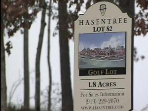A number of undeveloped properties in the upscale Wake Forest community of Hasentree Golf Course community are facing foreclosure, another sign, developers say, of an economy in the rough.