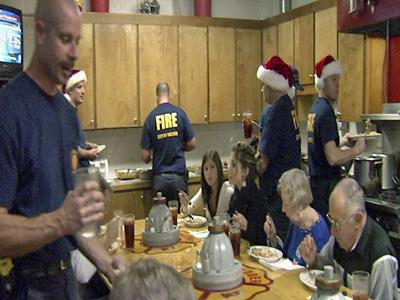 Firefighters and their families enjoy a Christmas meal Thursday evening.
