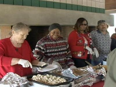 Barbara Tart shares her holiday fest with others Thursday afternoon.