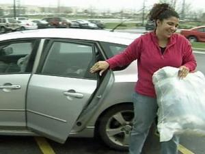 Jennifer Derby drops off items Sunday for Goodwill.