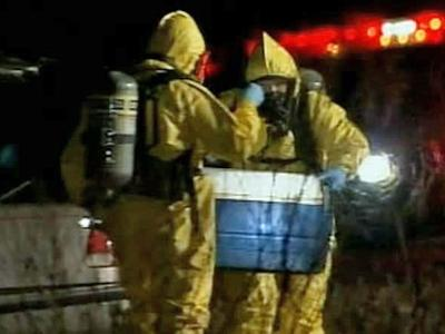 Hazardous-materials personnel removed a cooler from a car Tuesday on Raleigh and Shade Tree roads in Benson.