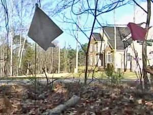 Flags mark the sites of old graves newly discovered in the Wake County subdivision of Turner Downs.