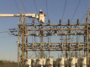 A crew member works on a power substation Friday morning. Parts of Smithfield lost power after a transformer exploded.