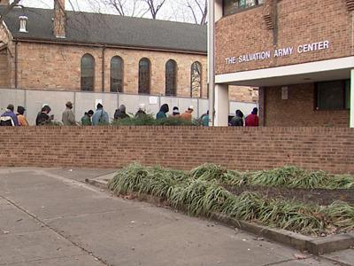 Lines are long outside the Wake County Salvation Army Wednesday as people seek help paying their utilities.