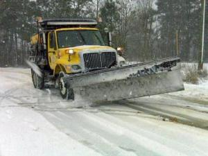 A truck plows a road during the snow storm Tuesday, Jan. 20.