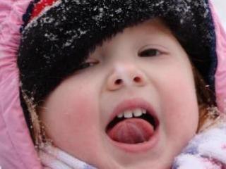 Sarah Pierce of Apex tastes snowflakes