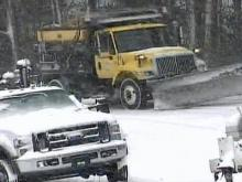 Road crews battle snow