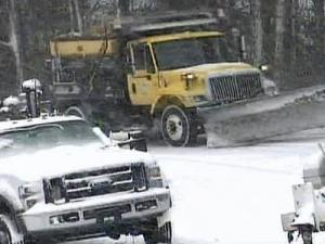 Road crews battle snow