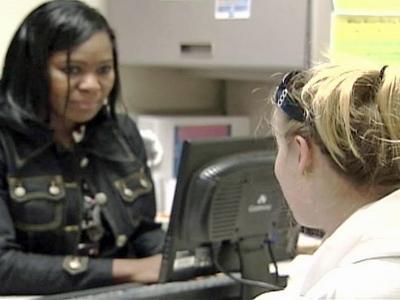 Shana Tull talks to an employee of the Wake County WIC office.
