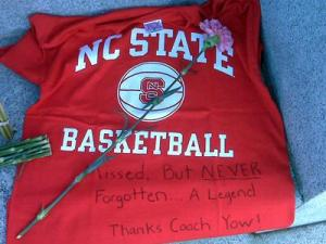 "Mourners left a flower and t-shirt with the message ""missed but never forgotten – a legend. Thanks Coach Yow,"" in front of the Bell Tower on N.C. State's campus on Jan. 24, 2009. Women's basketball coach Kay Yow died earlier in the day after a 21 year battle with breast cancer."