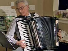 Fran the accordion man makes merry music