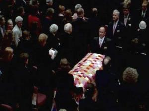 Kay Yow's quilt-draped casket is led out of Colonial Baptist Church in Cary after her Jan. 30, 2009, funeral.