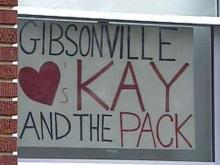 A sign showing support for N.C. State women's basketball head coach Kay Yow and her team.