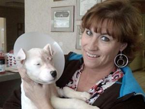 Highland Animal Hospital worker Robin Knapp and Lucky after the puppy had surgery to remove a punctured eye on Feb. 5, 2009.(Submitted by Jeanette Russell)