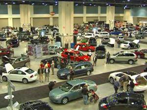 Cars and crowds spread out at the North Carolina International Auto Show in the Raleigh Convention Center Thursday, Feb. 5, 2009.