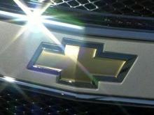 The Chevrolet logo shines in the sun on Feb. 6, 2009.