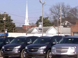 New cars sit on the lot at a Raleigh dealership.