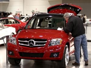 A spectator reads up on the latest mid-size SUV from Mercedes.