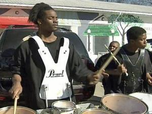 Members of the Helping Hand Mission Band play at the gravesite of their slain drum master Joshua Jermaine Bryant on Feb. 7, 2009.