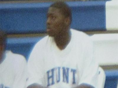 Anthony Eatmon, in an undated photo, sitting on the sideline of a basketball game.