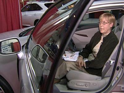 Shelia Fox, of Sanford, checks out a car at the 22nd North Carolina International Auto Expo at the N.C. State Fairgrounds on Feb. 12, 2009.